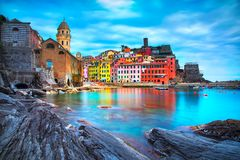 Vernazza village, church, rocks and sea harbor. Cinque Terre, Li. Vernazza village, church, rocks and sea harbor. Seascape in Five lands, Cinque Terre National Royalty Free Stock Photography