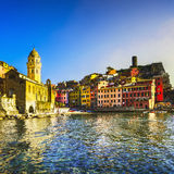 Vernazza village, church, rocks and sea harbor on sunset. Cinque Stock Photography