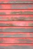 Vernice della sbucciatura, parete rossa Immagine Stock