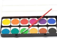 Vernice e spazzola dell'acquerello fotografia stock