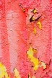 Vernice rossa e gialla della sbucciatura Immagini Stock