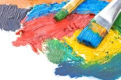 Vernici di colore e della spazzola su bianco fotografia stock