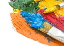 Vernici di colore e della spazzola su bianco immagine stock