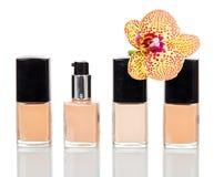 Vernici per il fiore del manicure, di pedicure e dell'orchidea isolato su bianco Immagine Stock