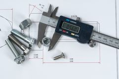 Vernier caliper and assorted screw, nuts and bolts. Assorted screw, nuts and bolts stock photos