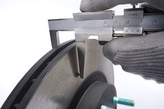 Vernier caliper on the brake disc close up. Brake disc of a car by checked for wear stock image
