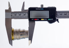 Vernier caliper and coins Royalty Free Stock Photography