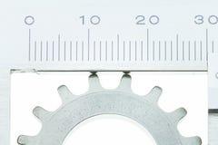 Vernier Caliper con la rueda de engranaje Imágenes de archivo libres de regalías