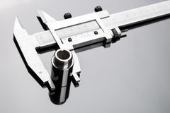 Vernier caliper and cylindrical part Royalty Free Stock Images