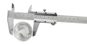 Vernier caliper with earth globe Stock Image