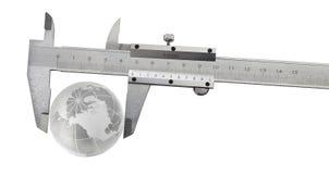 Vernier caliper with earth globe Stock Image