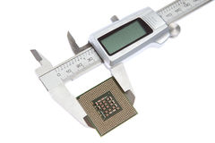 Vernier caliper measures the CPU. On a white background stock images