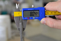 Vernier Caliper. Measuring the thickness of ceramic tiles Royalty Free Stock Photography