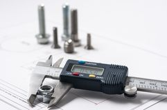 Vernier caliper with screw, nuts and bolts. Vernier caliper and assorted screw, nuts and bolts stock image