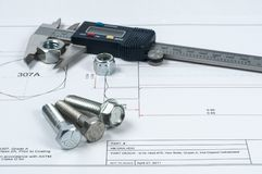 Vernier caliper with screw, nuts and bolts. Vernier caliper and assorted screw, nuts and bolts stock photos