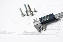 Vernier caliper with screw, nuts and bolts. Vernier caliper and assorted screw, nuts and bolts stock photo
