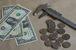 Vernier caliper and small money on the table