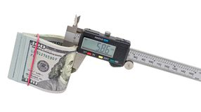 Vernier caliper and stack of $ 100 dollar bills. Isolated on white background royalty free stock image