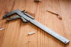A Vernier caliper. On a wooden table Stock Photos