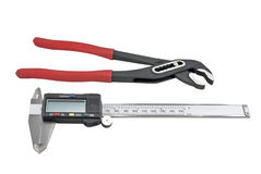 Vernier calipers and Red pliers Royalty Free Stock Images