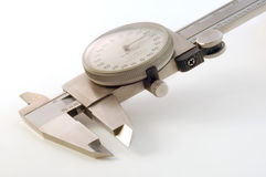Vernier Macro. Close up of vernier caliper on white royalty free stock photo