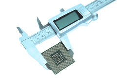 Vernier trammel  measures the CPU. Royalty Free Stock Photos