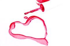 Vernis à ongles avec le symbole de forme de coeur Photographie stock