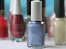 Vernis à ongles bleu Photographie stock libre de droits