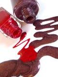 Vernis à ongles rouge et brun Photos libres de droits