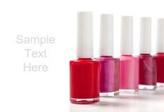 Vernis à ongles sur le blanc avec l'espace de copie Image libre de droits