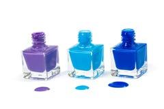 Verniz para as unhas azul isolado no fundo branco Fotos de Stock
