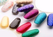 Verniz para as unhas em cores diferentes da forma Fotografia de Stock