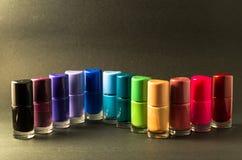 Vernizes para as unhas coloridos alinhados Imagem de Stock Royalty Free