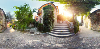 Verona. Panorama of cosiness yard with trees and tile passages in the city of Verona at early morning royalty free stock image