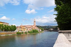Verona along the river Adige, Italy. View of the Adige River and the San Fermo Church in Verona, Italy Stock Images