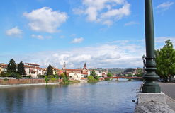 Verona along the river Adige, Italy. View of the Adige River and the San Fermo Church in Verona, Italy royalty free stock photos