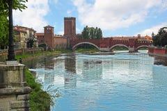 Verona along the river Adige, Italy. The Scaligero Bridge in Verona, Italy near Castelvecchio (Old Castle stock image