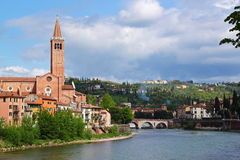 Verona along the river Adige, Italy. View of the Adige River and the San Fermo Church in Verona, Italy royalty free stock photography