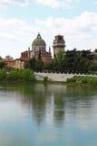 Verona along the river Adige, Italy. View of San Giorgio Church over the Adige river, in Verona Italy royalty free stock photography