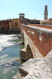 Verona along the river Adige, Italy. The old bridge in Verona, Italy. On the background the high tower of Duomo Royalty Free Stock Image