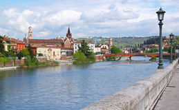 Verona along the river Adige, Italy. View of the Adige River and the San Fermo Church in Verona, Italy Stock Photo