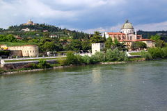 Verona along the river Adige, Italy. View of San Giorgio Church over the Adige river, in Verona Italy Stock Photos