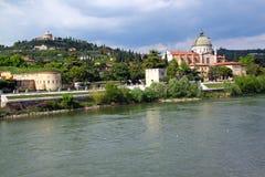 Verona along the river Adige, Italy. View of San Giorgio Church over the Adige river, in Verona Italy stock photos