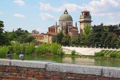Verona along the river Adige, Italy. View of San Giorgio Church over the Adige river, in Verona Italy royalty free stock photos