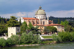 Verona along the river Adige, Italy. View of San Giorgio Church over the Adige river, in Verona Italy royalty free stock photo