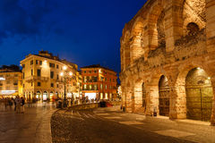The Verona Arena. Verona, Italy - May 07 2016: Some people walking on the Bra square nearby the Verona Arena, evening time Stock Images