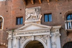 Verona - Bas-relief of the Venetian lion above the gate. Piazza dei Signori is the civic and political heart of Verona, Italy royalty free stock photography