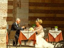Verona. Couple in a cafe near the tower Lamberti. Royalty Free Stock Images