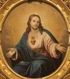Verona - hjärta av Jesus Christ. Målarfärg från kyrkliga Santa Anastasia Royaltyfria Foton