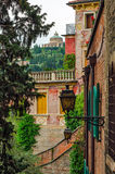 Verona Italy alley and Santuario Madonna di Lourdes Stock Photo